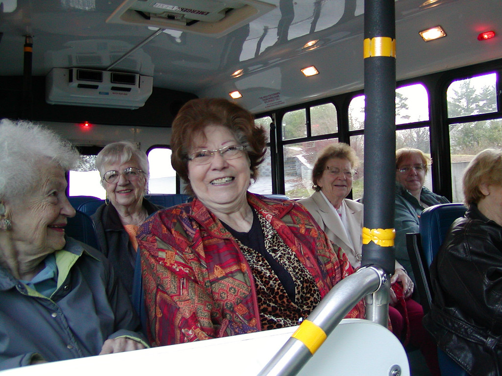Mom on the bus with her friends going to the Westford Adult Supportive Day Center