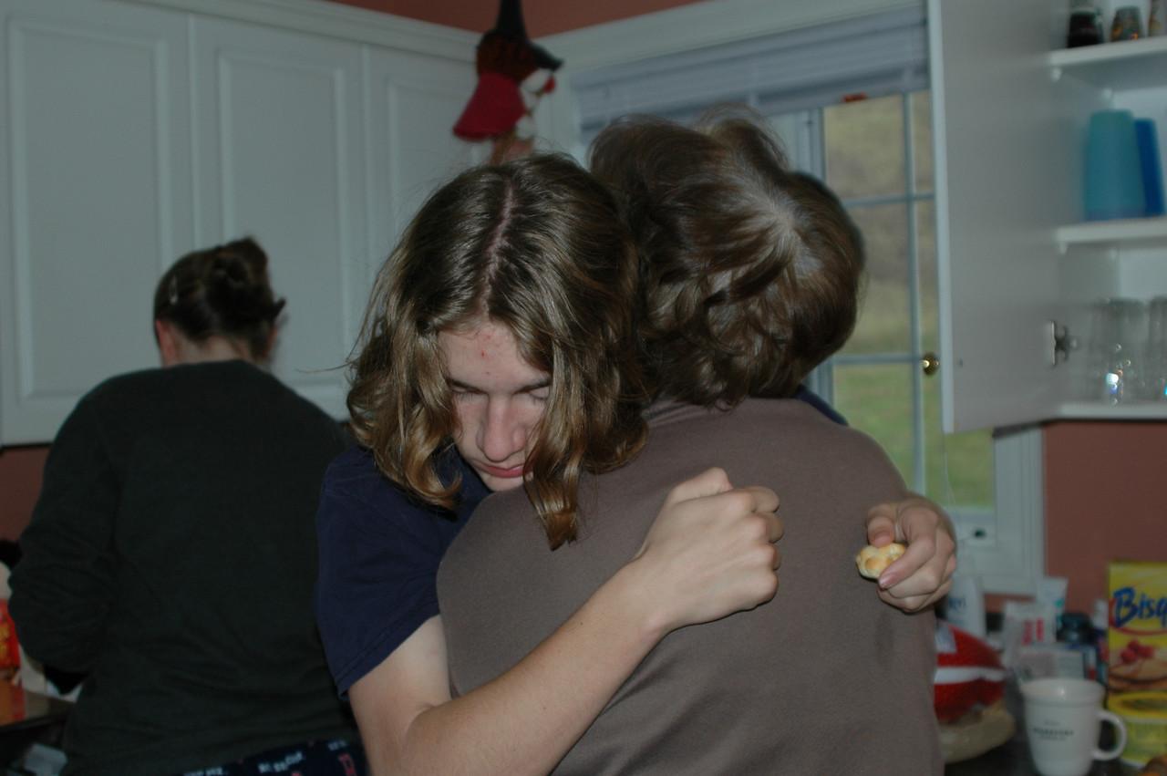 Ry gives Grandma a good morning hug